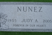 flush grave marker with angel